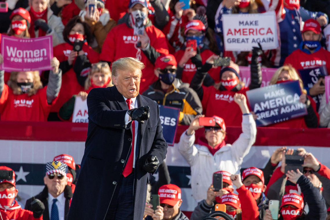 30 October 2020, US, Green Bay: US President Donald Trump speaks to the crowd during a campaign rally at the Austin Straubel Airport in Green Bay. Photo: Daniel Deslover/dpa.