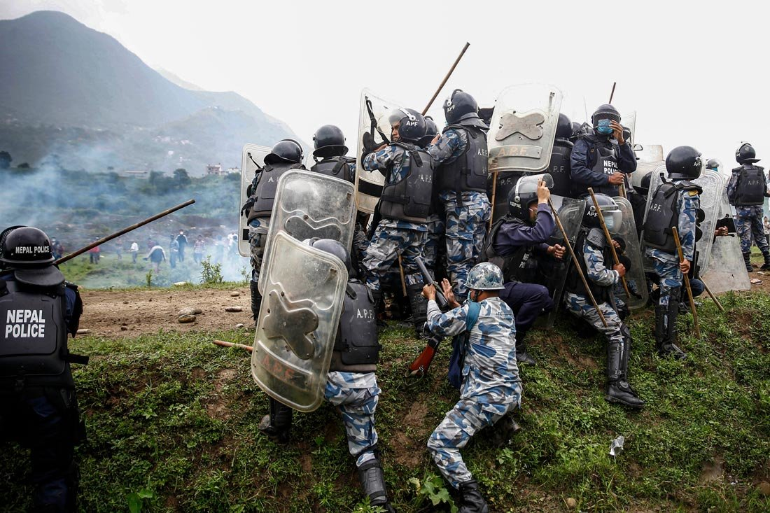 People calsh with policemen during a protest against the construction of a 76.2-kilometre-long Fast-track express railway that runs from Khokana of Lalitpur. Photo: Skanda Gautam/ZUMA Wire/dpa