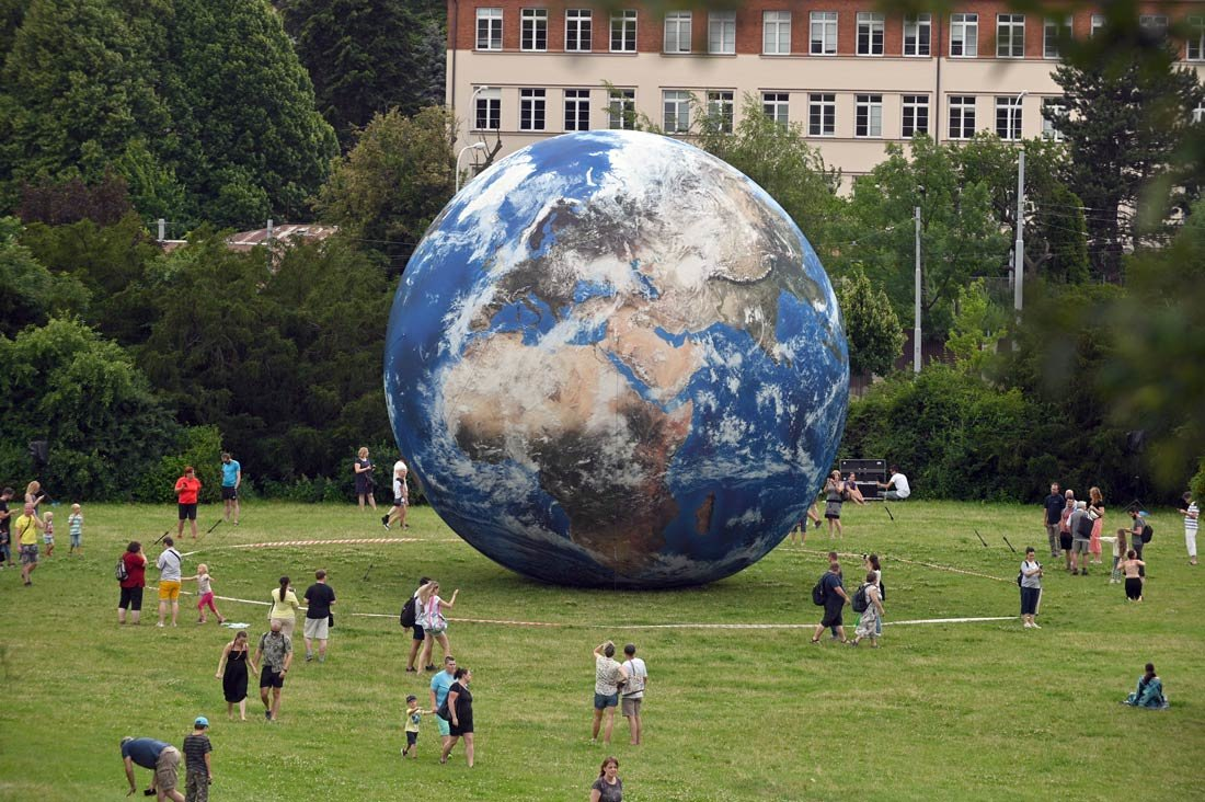 Czech Republic, Brno: People watch the giant inflatable Earth planet which is displayed near Brno Observatory and Planetarium. Photo: Igor Zehl/CTK/dpa