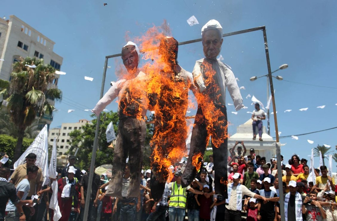 "Palestinian Territories, Gaza: Palestinian supporters of al-Ahrar movement burn effigies depicting (L-R) US President Donald Trump, Trump's Middle East peace plan dubbed as the ""Deal of the Century"", and Israeli Prime Minister Benjamin Netanyahu as they take part in a march marking the 13th anniversary of its founding, and protest against the Israeli annexation plan that will occupy about 30 percent of the West Bank area. Photo: Mahmoud Ajjour/APA Images via ZUMA Wire/dpa"