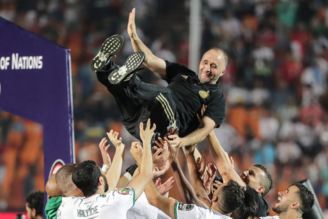 Egypt, Cairo: Algeria players toss Algeria's national team coach Djamel Belmadi (top) as they celebrate winning the 2019 Africa Cup of Nations final soccer match between Senegal and Algeria at the Cairo International Stadium. Djamel Belmadi confirmed that he will never forget the feeling of crowning the title of the 2019 African Nations Cup, held in Egypt, and carried the cup to Algeria. Photo: Oliver Weiken/dpa