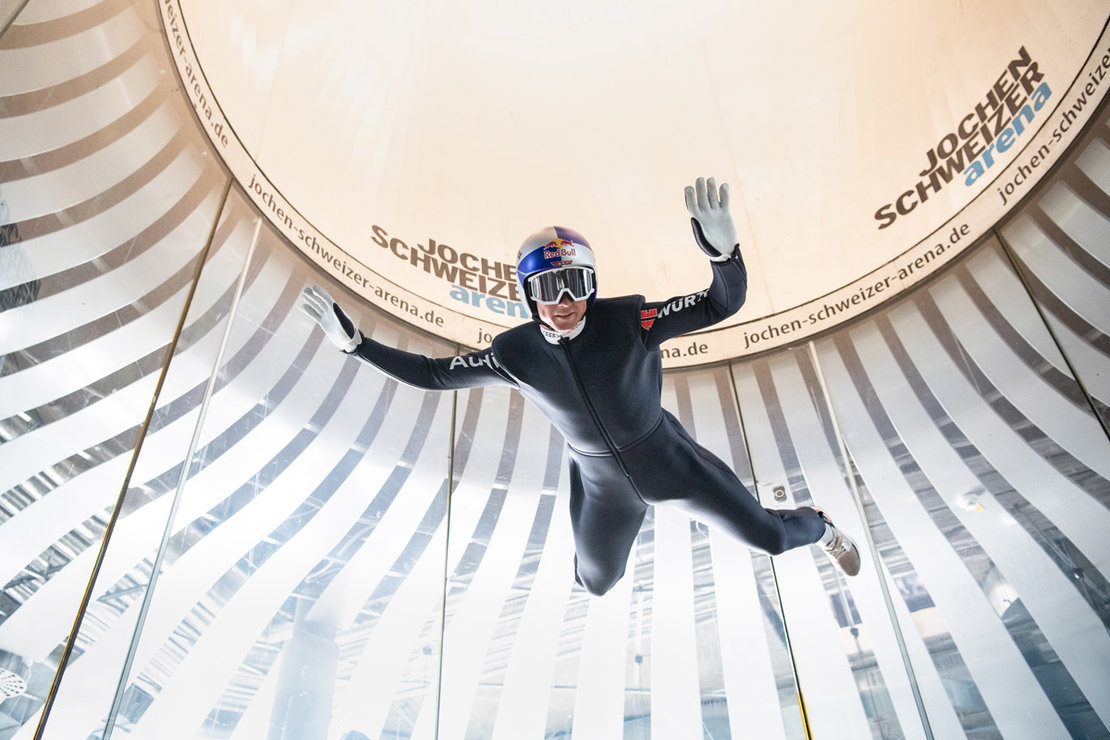 20 July 2020, Bavaria, Taufkirchen: German nordic combined skier of the national team in Nordic combination Vinzenz Geiger flies in the wind tunnel at a media event of the German Ski Association (DSV) at the Jochen Schweizer Arena. Photo: Matthias Balk/dpa.