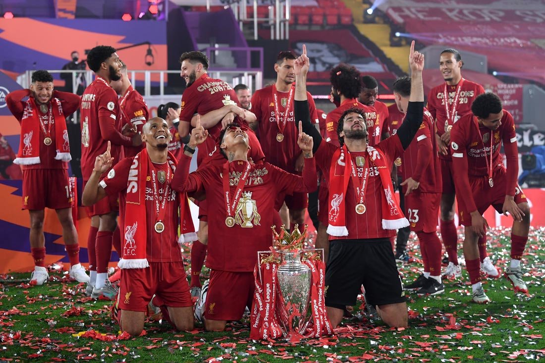 England, Liverpool: Liverpool's Fabinho, Roberto Firmino and Alisson Becker celebrate with the Premier League trophy during the trophy presentation after the end of the English Premier League soccer match between Liverpool and Chelsea at the Anfield. Photo: Laurence Griffiths/dpa.