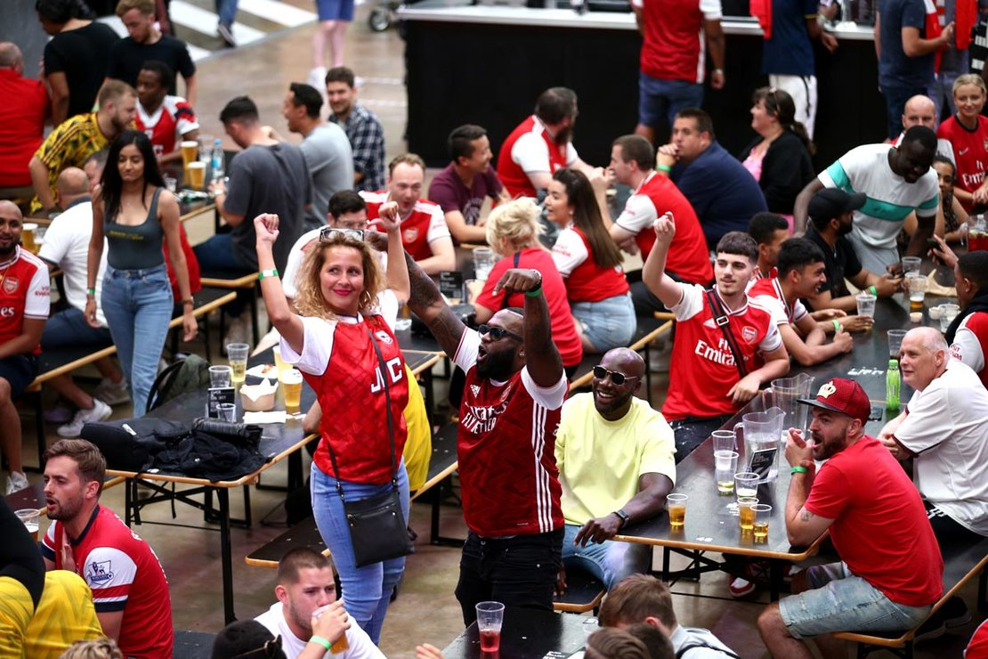London: Fans cheer at Box Park Wembley in London to watch the FA Cup final soccer match between Arsenal and Chelsea, taking place at Wembley Stadium. Photo: Yui Mok/dpa.