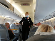 15 July 2020. A cabin crew member, wearing a mask and gloves, on a Finnair flight. Photo: Foreigner.fi