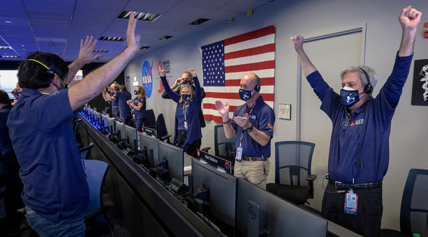 18 February 2021, US, Pasadena: Members of the NASA Perseverance Mars rover mission team cheer as the spacecraft successfully land on Mars, at the NASA Jet Propulsion Laboratory in Pasadena. NASA's Mars rover Perseverance landed on the Red Planet on Thursday after a roughly 480-million-kilometre journey through space, the first probe from Earth to reach Mars since 2018. Photo: Bill Ingalls/Nasa/Planet Pix via ZUMA Wire/dpa