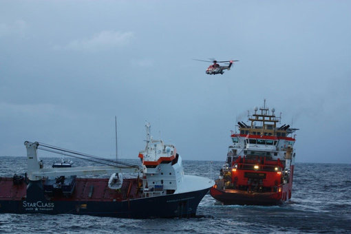 The dutch cargo ship Eemslift Hendrika is seen during the rescue operation. Photo: @kystvakten/KV Bergen.