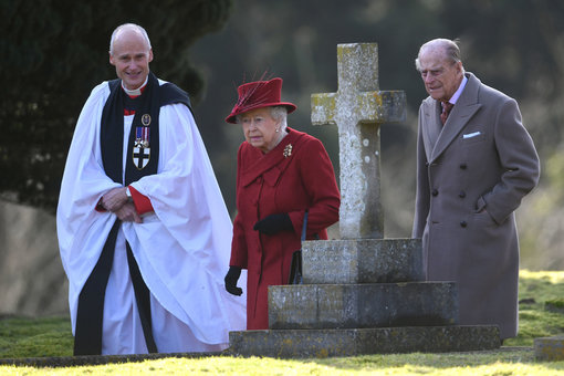 FILED - 04 February 2018, United Kingdom, West Newton: Queen Elizabeth II (C) and Prince Philip, the Duke of Edinburgh, with Canon Jonathan Riviere (L) attended St Peter and Paul Church in West Newton. Prince Philip died on Friday at the age of 99. Photo: Joe Giddens/PA Wire/dpa