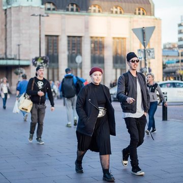 People passing in front of Helsinki central train station. Photo: Julia Kivela/Visit Finland.
