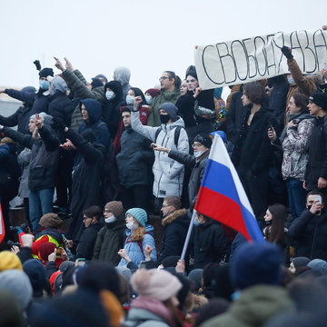 23 January 2021, Russia, Saint Petersburg: Protesters chant slogans during a demonstration against the detention of the Russian opposition leader Alexei Navalny who was arrested on his return to Russia from Germany. Photo: Sergei Mikhailichenko/SOPA Images via ZUMA Wire/dpa