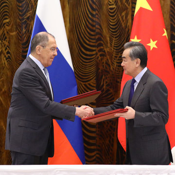 HANDOUT - 23 March 2021, China, Guilin: Russian Foreign Minister Sergey Lavrov (L) shakes hands with Chinese Foreign Minister Wang Yi as they exchange signed documents during a signing ceremony after their meeting. Photo: -/Russian Foreign Ministry/dpa - ATTENTION: editorial use only and only if the credit mentioned above is referenced in full