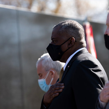 HANDOUT - 29 March 2021, US, Washington: US Defence Secretary Lloyd Austin (C) takes part in a wreath laying ceremony at the Vietnam Veterans Memorial wall during the National Vietnam War Veterans Day. Photo: Lisa Ferdinando/US Secretary of Defence/dpa - ATTENTION: editorial use only and only if the credit mentioned above is referenced in full