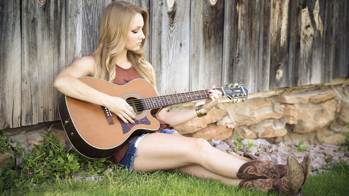 Woman-guitar-play-girl-contry-boots-music