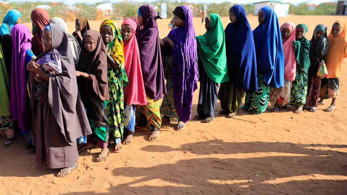 Internally displaced girls in Somalia queue before at a school beside an IDP camp in Dollow, Somalia. Photo: Reuters/Zohra Bensemra.