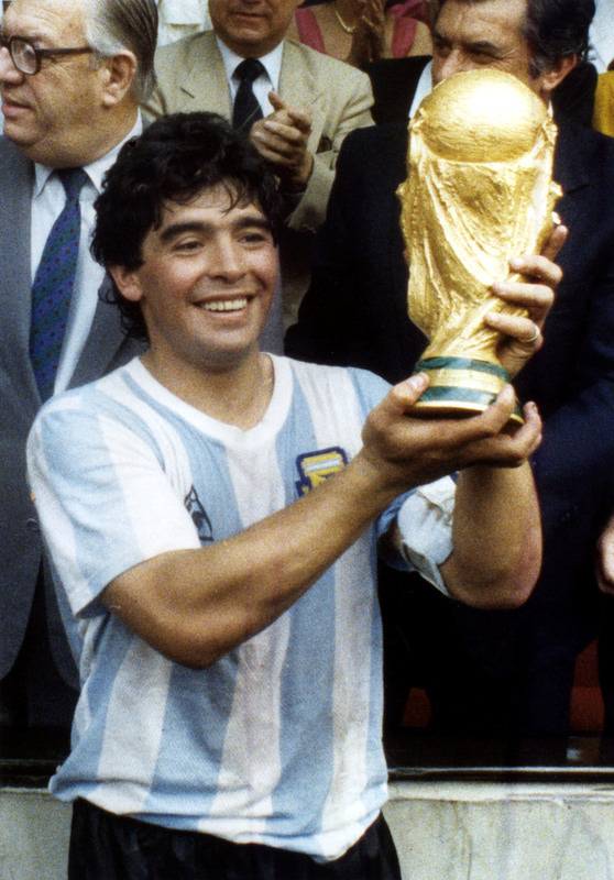 FILED - 29 June 1986, Mexico, Mexico City: Argentina's Diego Maradona holds up the World Cup trophy after his team's victory over West Germany in the 1986 FIFA World Cup Final. Argentina football great Diego Maradona has died at the age of 60, the Argentinian Football Association said on Photo: dpa.