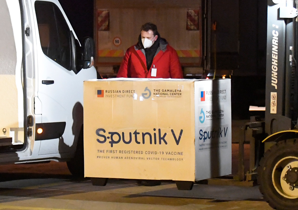 01 March 2021, Slovakia, Kosice: A worker unloads boxes of Sputnik V's Coronavirus vaccine doses from an aircraft upon its arrival from Moscow at Kosice International Airport. Photo: František Iván/TASR/dpa